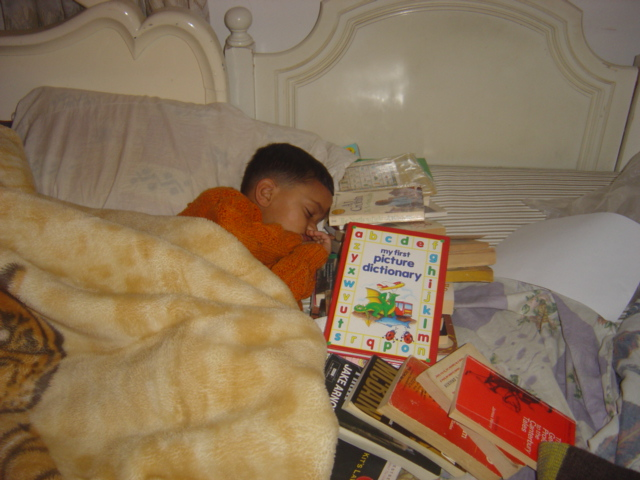 Sahil Bhatt-Sleeping with his books.Dec 2004. When he was 4 years old. Getting them into the reading habit..from a young age
